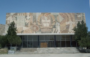 """Knowledge is light"" - mosaic on the front side of the gymnasium displaying the national collage of symbols that represent each area of study."